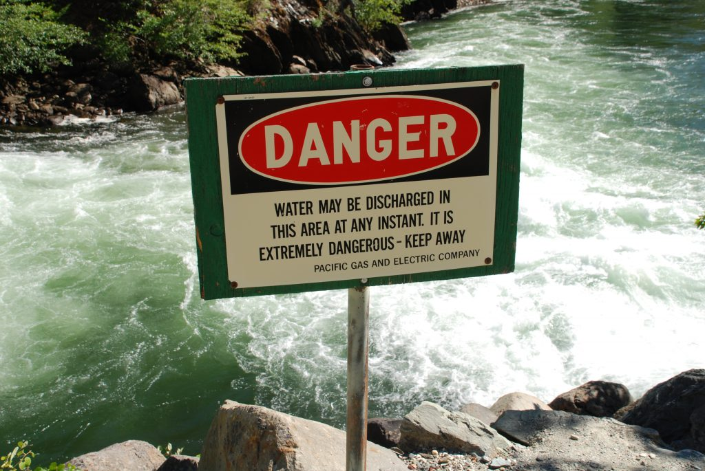 Warning sign at the outlet for the Caribou 2 Powerhouse.