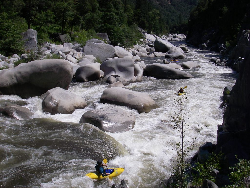 Rafter runs cleaver on the Tobin section of the North Fork Feather River. Normally flows are diverted from this section by the Rock Creek Dam, but flows are restored a few times each summer and enjoyed by recreational boaters.